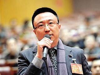 曹志伟:更关心如何解决停车难问题